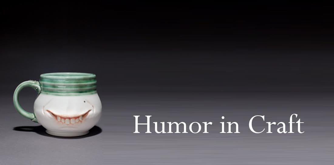 humor in craft, with a mug that has vampire teeth