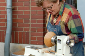 a woman sewing at a machine