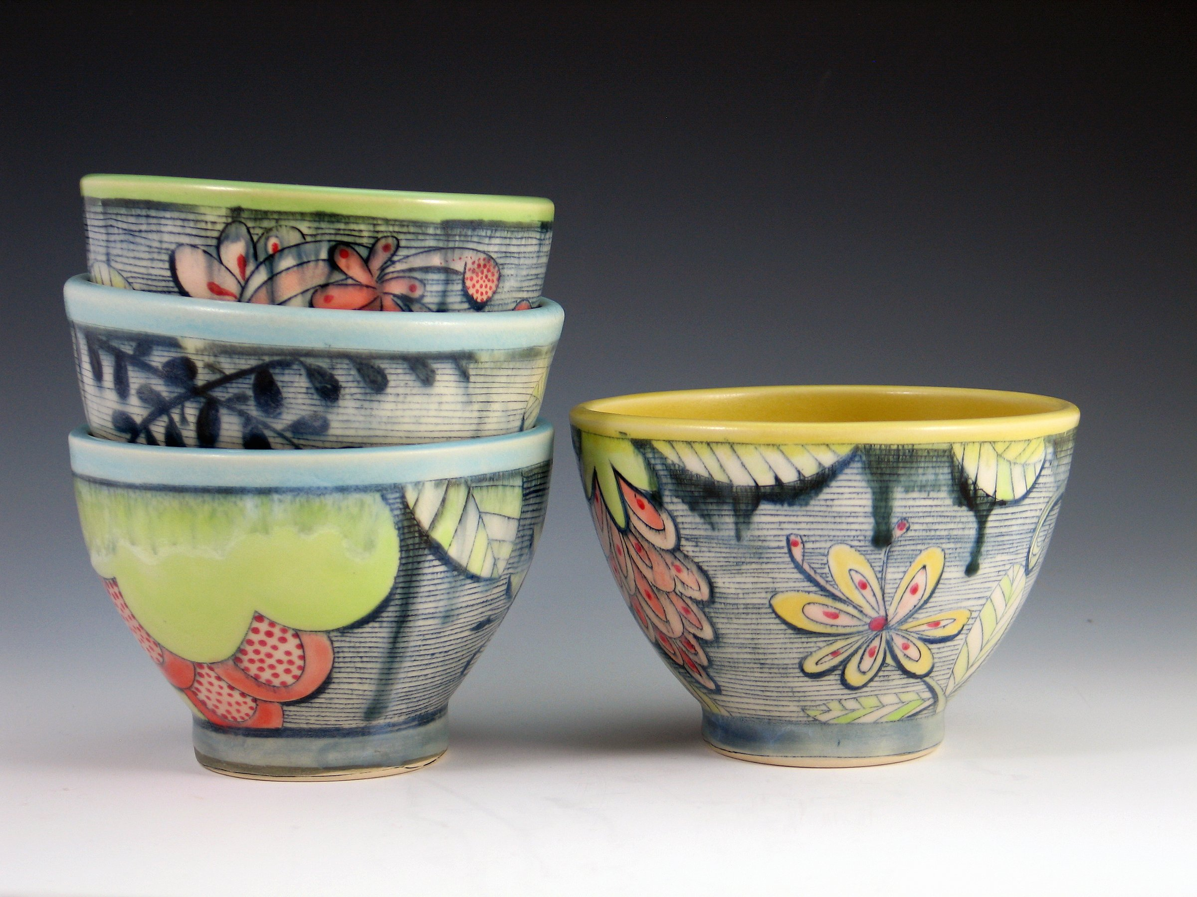 Stack of colorful ceramic bowls by Chandra DeBuse