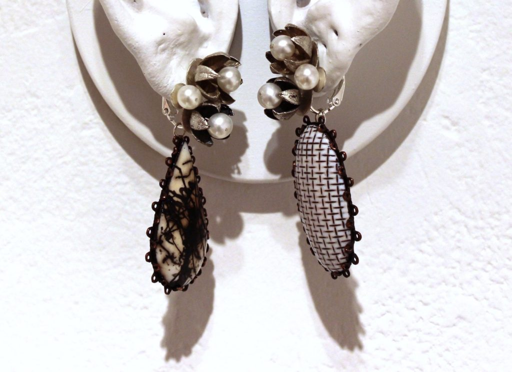 Hosanna Rubio's asymmetrical earrings called Dowry Earrings with different enamel patterns on each piece.
