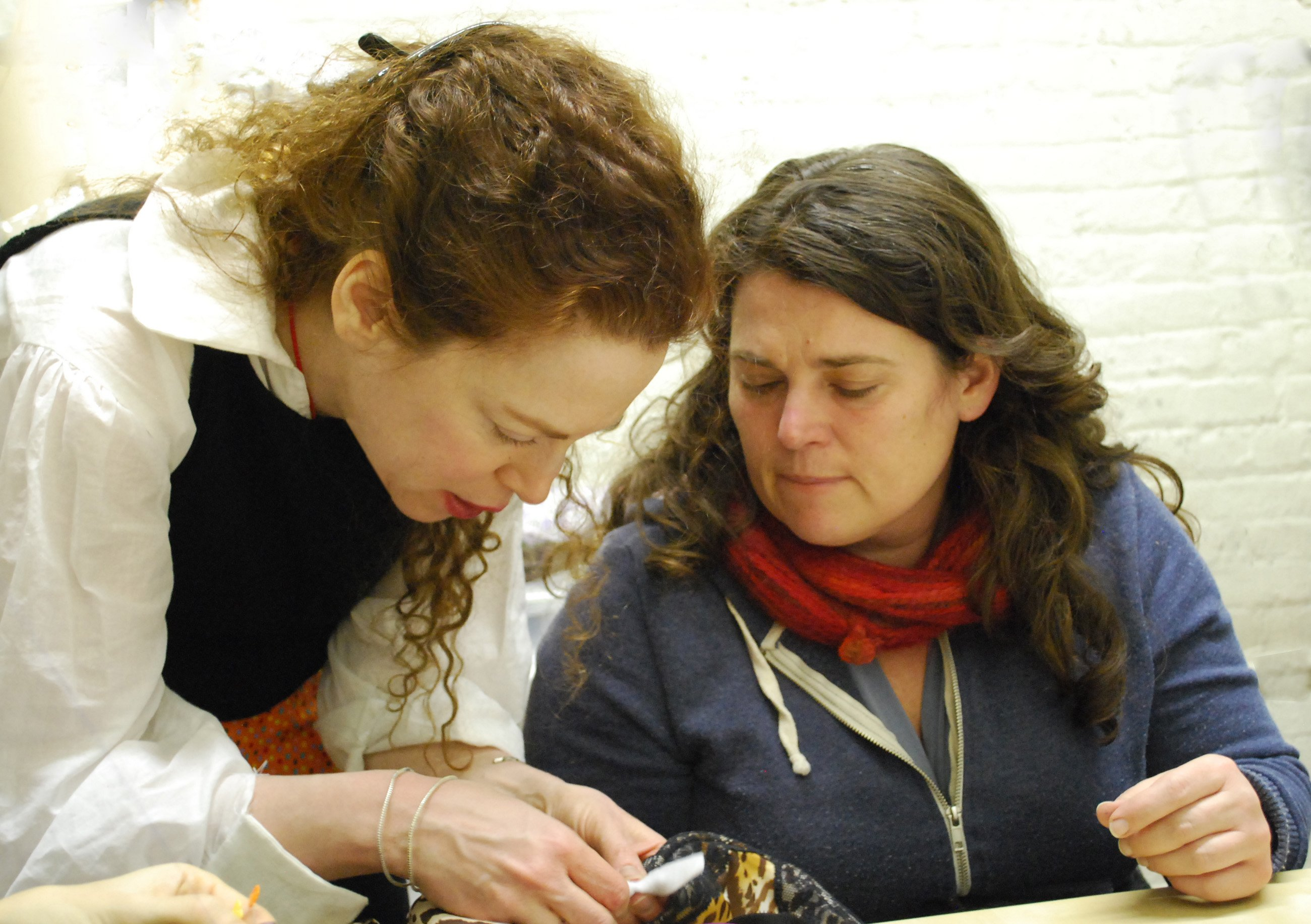 Sarah Kate Beaumont teaching mending to a student