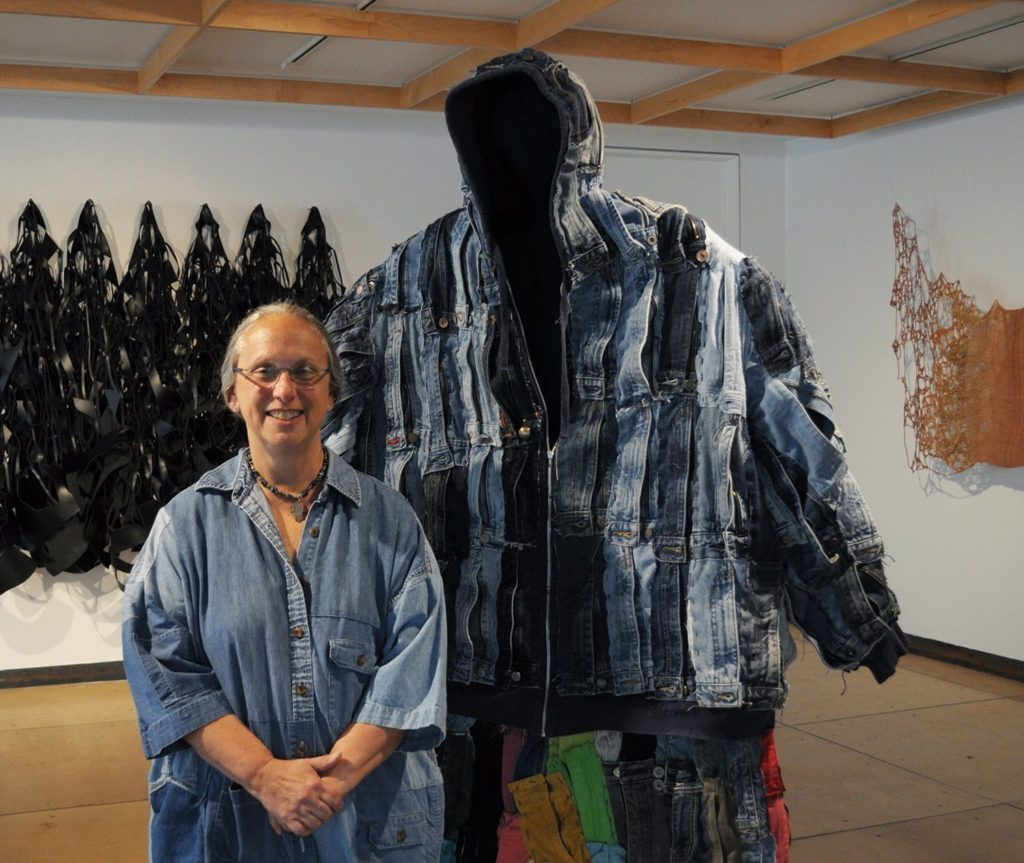 Louise Silk with her work at Fiberart International 2019